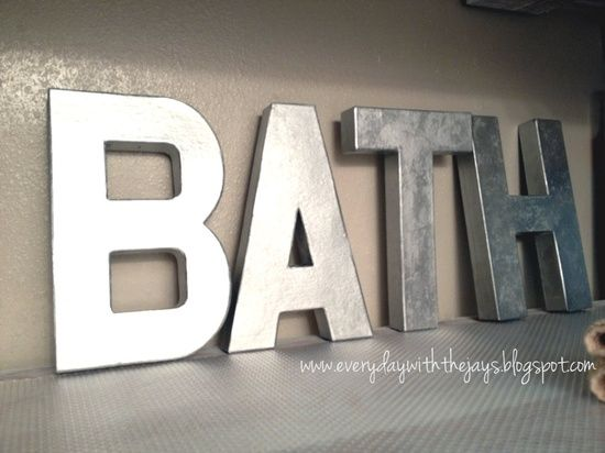 "Hobby Lobby cardboard letters painted with metallic spray paint. They're so light you can hang them using 3M sticky strips. Much cheaper than Anthropologie at only $2.50 a pop. Do ""wash"" for the laundry room."