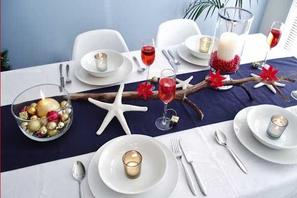 Here in the northeast we don't think warm and beachy at Christmastime - unless we're trying to escape the bitter cold and snow. What I love about this coastal Christmas table is how richly winter and festive it looks, all while still incorporating classic seaside details. Starfish and cranberries can work together!