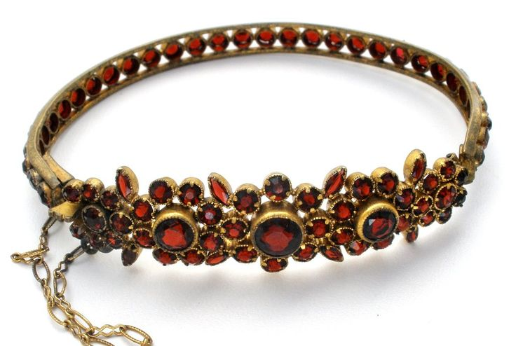 """Antique Gemstone Jewellery - This is a gold over 900 silver a Victorian bangle bracelet with 8.6 cts of garnets. It is slightly over 1.5"""" at widest point, .25"""" in back, weighs 12.1 grams, has slide in"""