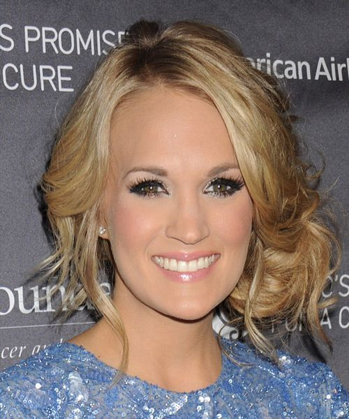 Carrie Underwood's long curly formal updo  blonde hair color with blond highlights
