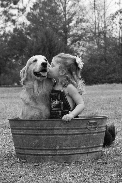that girl is so sweet. that dog is so happy.