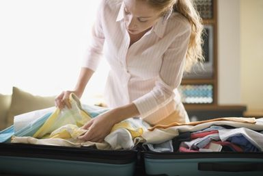 What Matters and What Doesn't: Picking the Best Suitcase for Travel: Woman with suitcase