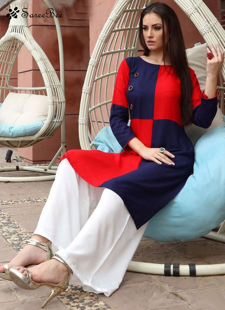 Energetic Rayon Navy Blue And Red Party Wear Kurti  Add a vibrant burst of color to your wardrobe with this navy blue and red rayon party wear kurti. The lovely plain work a substantial feature of this attire.