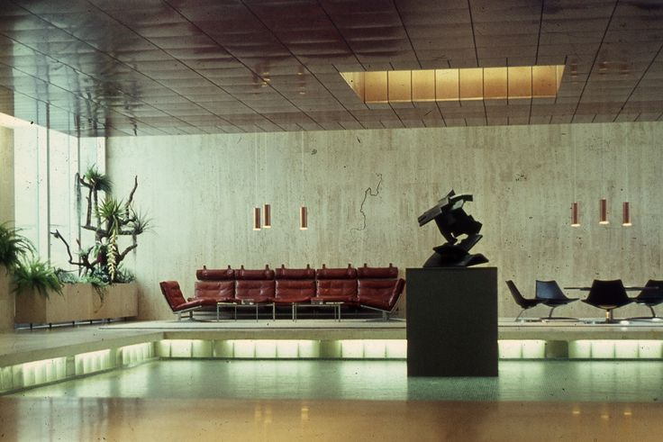 A beautiful Swiss bank interior featuring bo-ex furniture pieces by Fabricius & Kastholm. Cirka mid-1960s. Pictured are: bo-565 sofa, bo-561 lounge chairs, Scimitar chairs and no. 70 cocktail table.