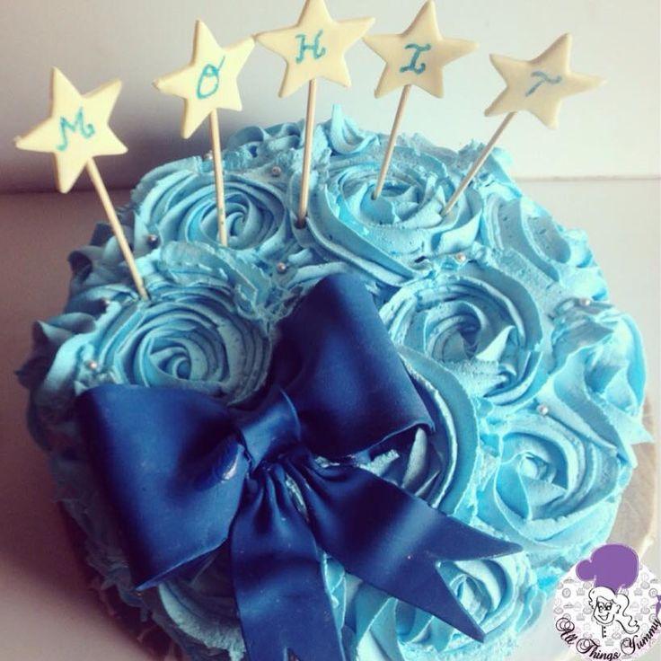 Cakes Decor Rosettes - A Blue Tweaked Rosettes Decor Cake | All Things Yummy #allthingsyummy #pink #rosettes #cake #icing #buttercream #blue #bluerosettes #bow #fondantbow #foodphotography #stars #atyummy #cookiesticks #desserts #delhibakery #customisedcake #chocolatecake #cakes #cake #happybirthday #birthdaycake