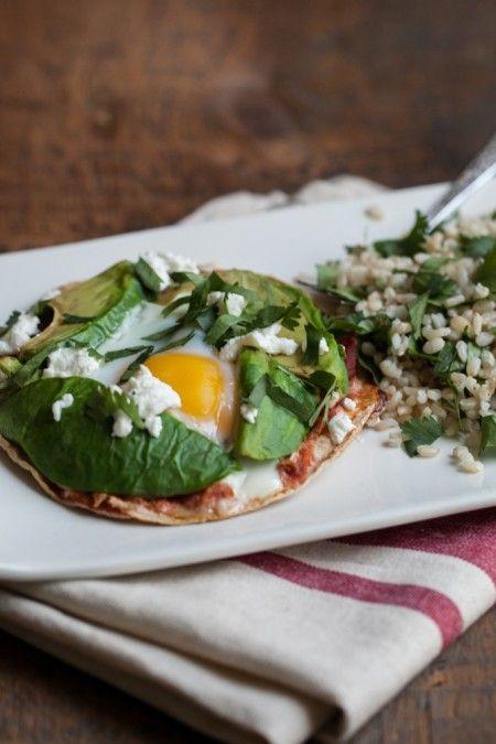 [ Recipe: Baked Egg and Avocado Tostadas ] Using Corn Tortillas, salsa, avocados, eggs, goat cheese, and cilantro. ~ from NaturallYella.com