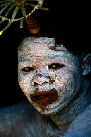 Africa | Xhosa Initiate with Painted Face.  South Africa | ©Roger De La Harpe