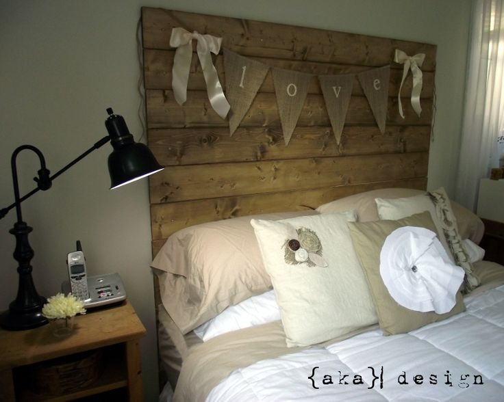 """rustic headboard -- 1""""x6""""x5' boards screwed to the wall and stained (minwax special walnut).  Finished size: 5' (width of bed) x6'.  Add shelf w/lighting under"""