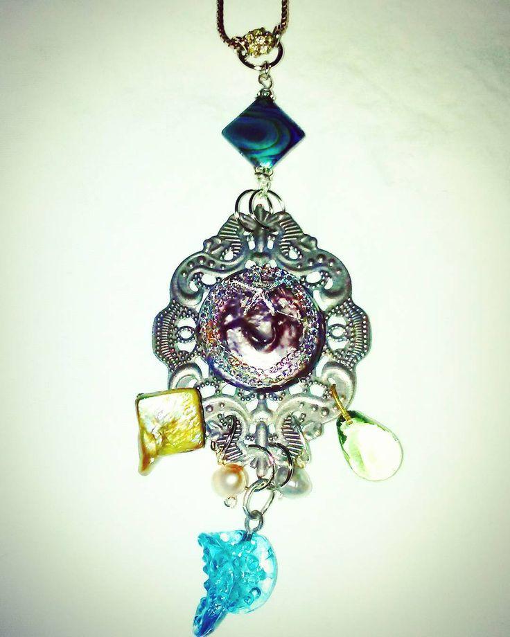 Sea siren necklace  DM to order #amandanancedesigns #handmadejewelry #ocean #sea #aquatic #nautical #jewelry #necklace #oceanjewelry #purple #blue #green #gold #silver #abalone #pearl #glass #starfish #seasiren #oceanlife #tx #texas #global #madeintexas #dallas #fortworth #dfw #atx #austin #metroplex