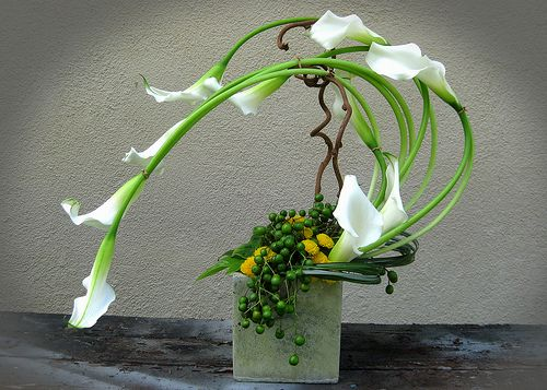 I am always at a loss on how to make flower arrangements unique. This inspires me.