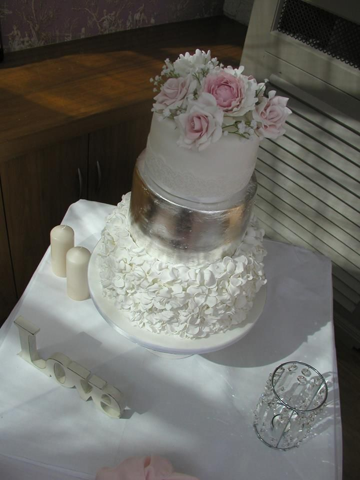 edible silver wedding cake with handmade sugar roses pink. with a white petal ruffle
