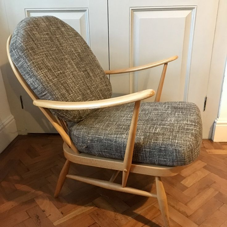 Classic blonde Ercol chair re-upholstered in Warwick Coco Thunder fabric!