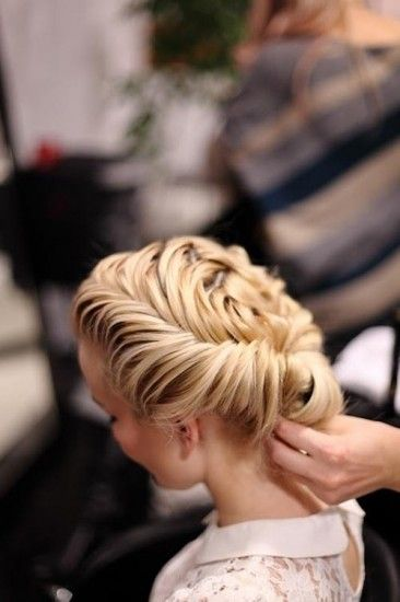 An intricate updo is hard to miss at prom Isn't this hairstyle beautiful?! We'd pair it with something bright and sparkly. #prom2013 #promhair #davidsbridalprom
