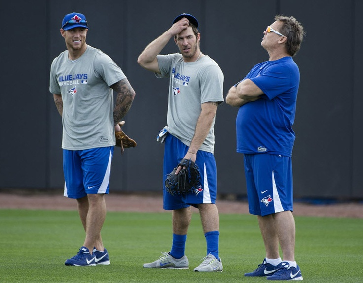 Toronto Blue Jays Brett Lawrie, left, and J.P. Arencibia, centre, talk with manager John Gibbons while working out at the Blue Jays' Spring Training facility. (via http://sports.nationalpost.com/2013/02/12/the-best-photos-from-the-blue-jays-first-day-of-spring-training/ )