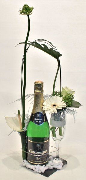 Flower gift arrangement with bottle of cider and glass-white corsage