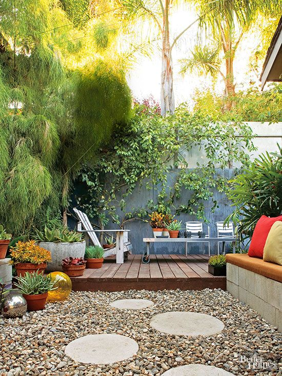 This outdoor room looks expensive. but that's just what the homeowner wants you to think. Inexpensive building materials such as gravel, cinder blocks, and pressure-treated wood form the backbone of the design. Tile backboard and salvaged plywood, stained a soft blue and attached to a custom frame, give the tiny yard privacy.
