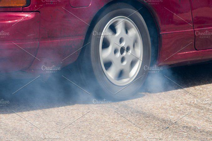 Rear wheel drive car burning tire by Fotoeventis on @creativemarket