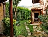 Green gardens and Cretan mountains from the Yades Kalimera Arhcanes Village Crete