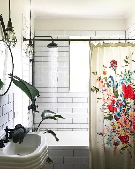 Black and white bathroom with color pop curtain