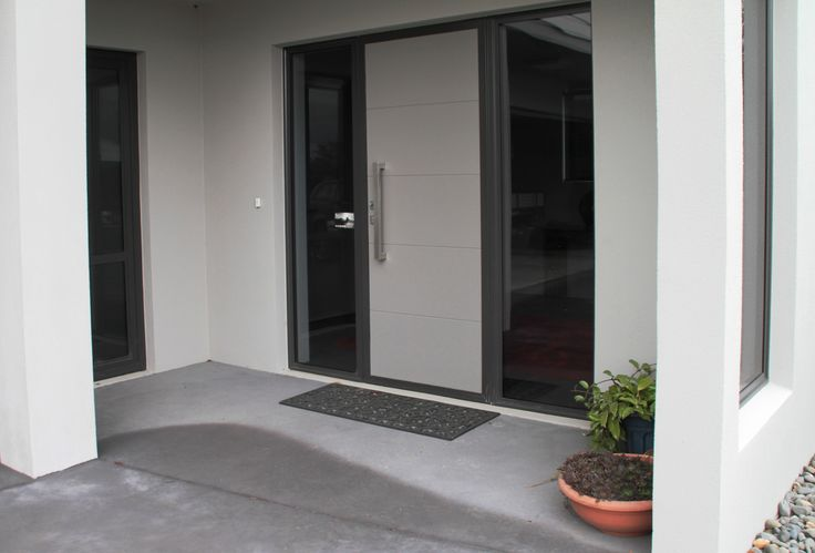 Aluminium doors and windows create a stylish entrance way.