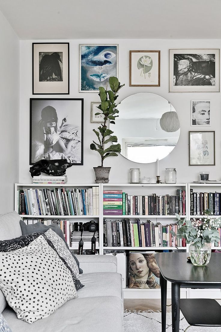 The livingroom sofa white galery wall picture eclectic mirror round plants ikea billy bookcase white bookshelf styling living room room