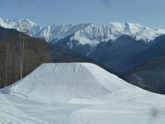 Sochi's first big kicker on the ski and snowboard cross course. (ATR) For the lastest news on the Olympics go to http://aroundtherings.com or add us on Facebook. http://facebook.com/aroundtherings