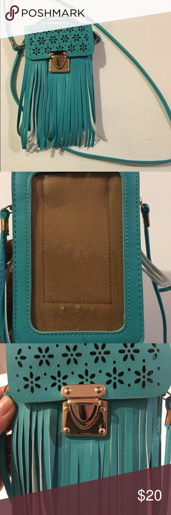 BRAND NEW never used Turquoise Fringe Crossbody This super cute turquoise fringe crossbody has been in my closet for over a year! Purchased brand new from a boutique booth at the NFR in Las Vegas. Excellent condition! Clear plastic side is a pocket for your phone which allows you to text on your touch screen while phone is inside the purse! I have a iPhone 6s and it fits perfectly. Bags Crossbody Bags