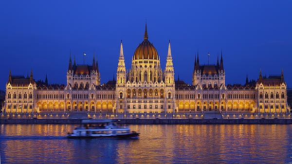 The Hungarian Parlement in beautiful lights - Budapest, Hungary. If you like the picture, hang it on your wall! Just a single click on it...