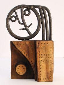 Percz János (1920 - 2000) Lófarkas lányfej vas, fára applikálva 22 x 6 x 12 cm 216/17