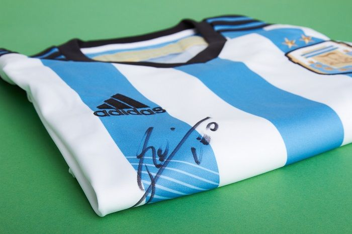 WIN this signed Messi shirt!