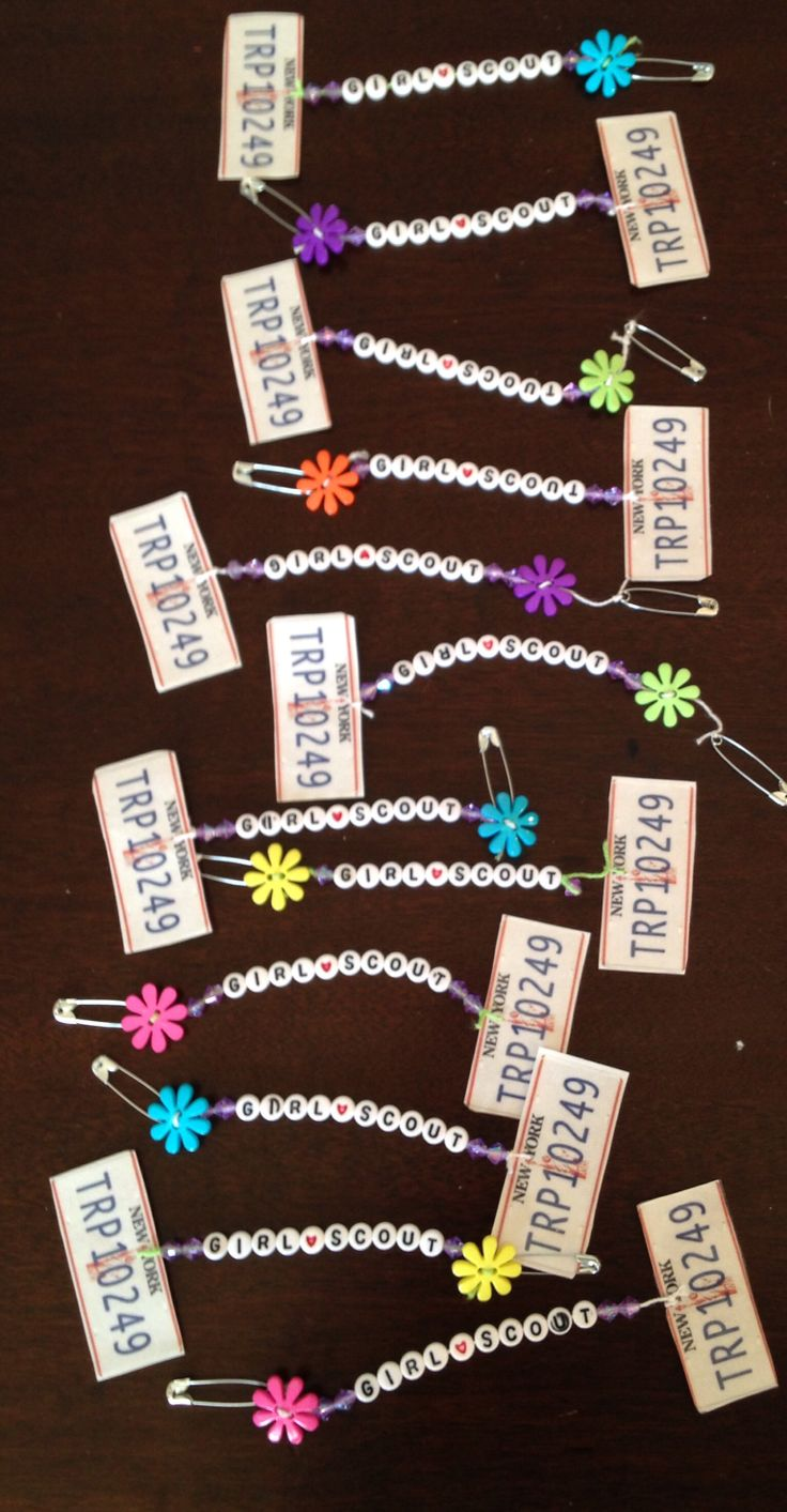"Be a sister to every Girl Scout, swaps.   We are working on a ""Daisy Chain"" a chain letter package w/8 other troops. Each troop will fill out a troop questionnaire, make swaps, and include a troop pic & hometown pic. This is the swap my girls will be making for the troop who will be receiving the package from us. I went through 2, 400 count packages of letter beads & didn't have enough ""s"" to spell ""gssister"" the mini license plate is the best!!"