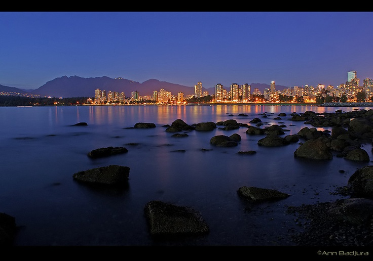 A view towards downtown Vancouver from the beach between Kitsilano Beach and Vanier Park in Vancouver, Canada.