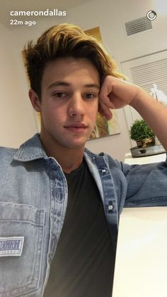 "::Cameron dallas::""hey! I'm cameron, but call me cam""i smile""I'm  18 and single. I'm one of the most popular guys in school. I'm captain of the football team and I play lacrosse. I'm very rich and my parents are really famous. Ari is my sister and if you hurt her, just know it won't end well. Anyway, that's it about me! Come say hi?"""