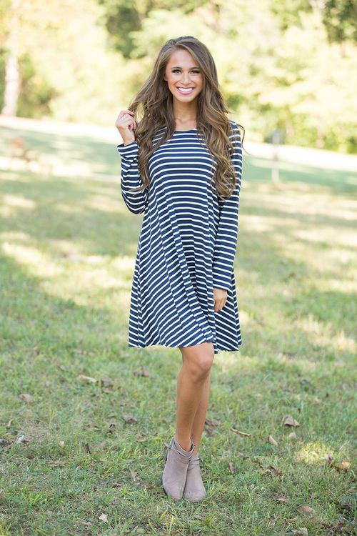 This lightweight striped dress is such a fall essential! We adore the beautiful navy and white stripes paired with the flattering silhouette - it's always a winning look!