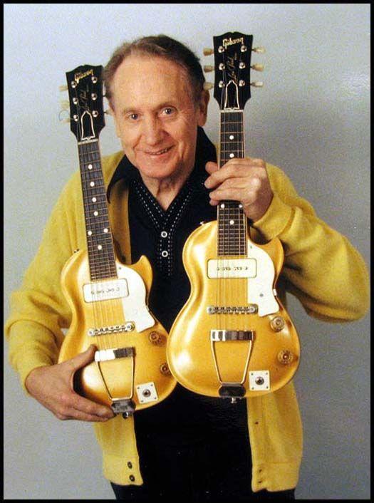 "Les Paul, the man with his ""Mini Me"" miniature Les Paul guitars."