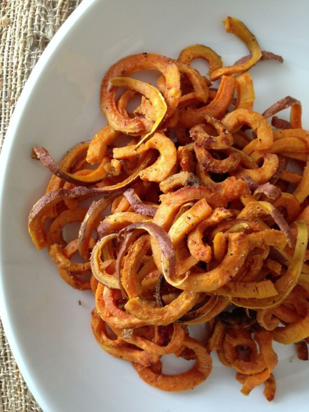 Paleo Baked Sweet Potato curly fries! Can't wait to get a spiral veggie slicer.
