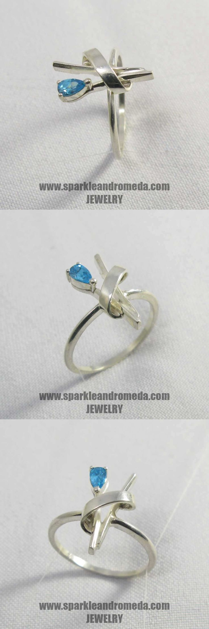 Sterling 925 silver ring with 1 pear 5×3 mm blue color cubic zirconia gemstones.