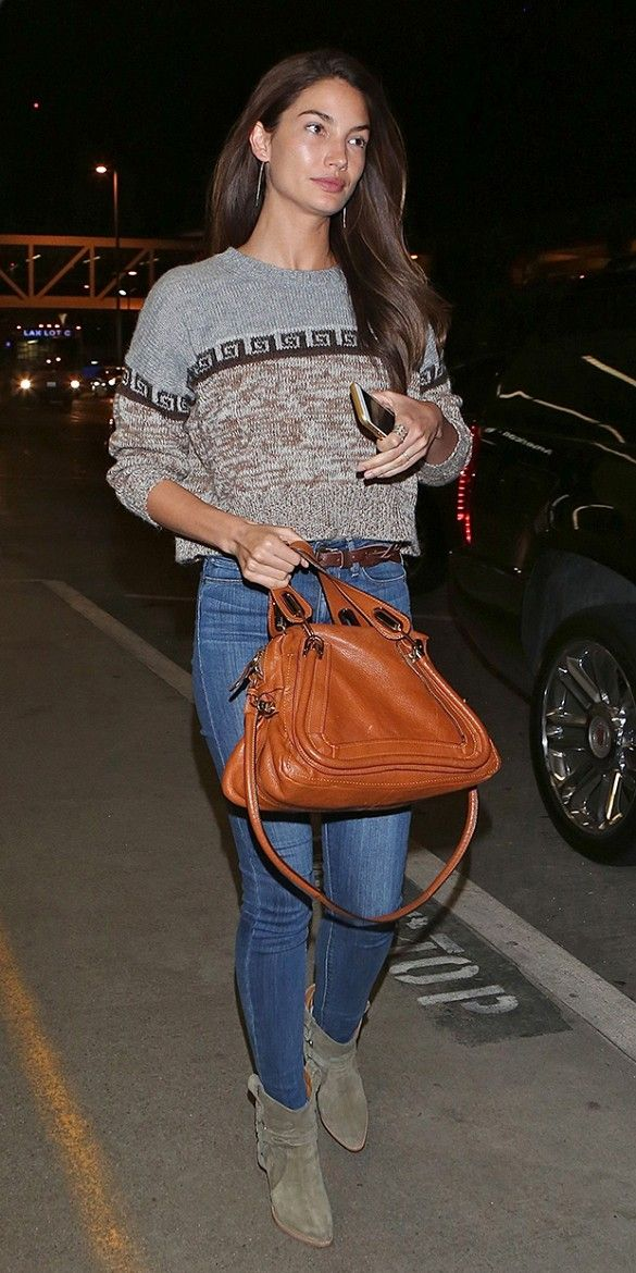 Lily Aldridge wearing a printed Isabel Marant sweater, skinny jeans, and suede boots at LAX
