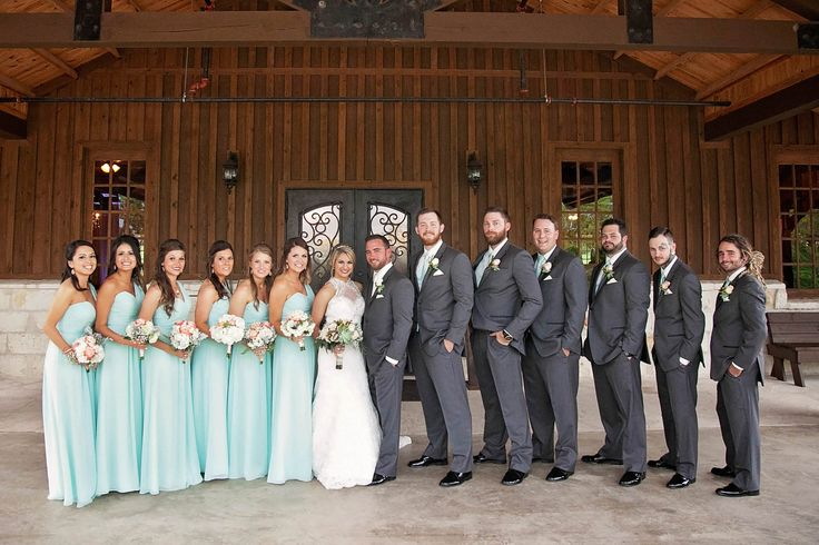 The wedding party was dressed to match the springtime nuptials, but still kept their style formal. The bridesmaids wore a mint chiffon Bill Levkoff dresses, and the groomsmen sported a gray slim-fit Vera Wang suit with a mint vest and tie to match.