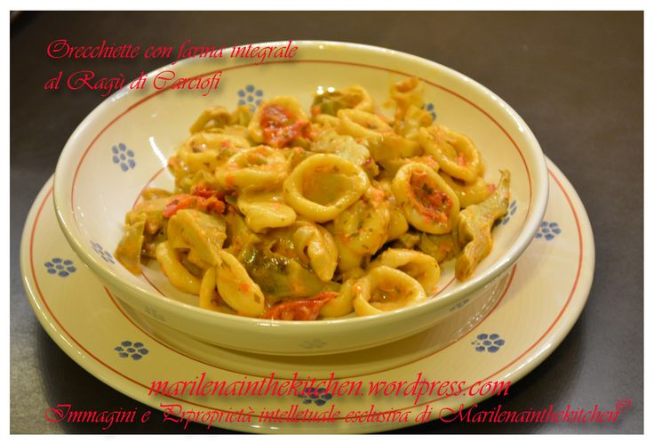 Oricchiette with meat sauce and artichokes.