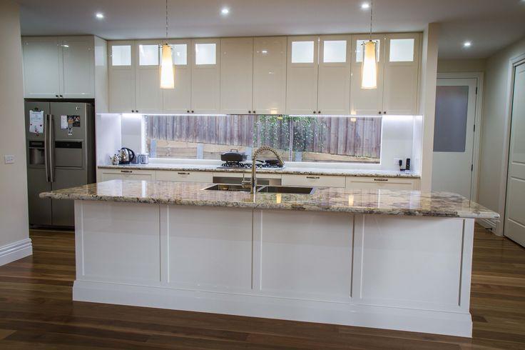Galley kitchen. Window splashback. Traditional kitchen. Island bench. Granite benchtop. www.thekitchendesigncentre.com.au