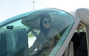 Afghanistan's first female pilot, Niloofar Rahmani, 23, sits in a fixed-wing Afghan air force aviator aircraft in Kabul in 2015