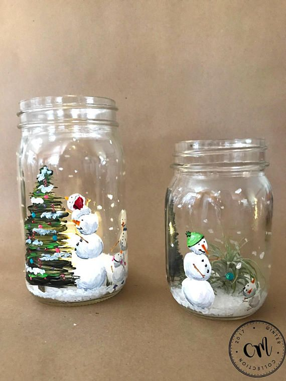 This Is A Winter Themed Hand Painted Mason Jar Featuring A Snow Family Decorating A Christmas Tree Xmas Crafts Christmas Mason Jars Mason Jar Candle Holders