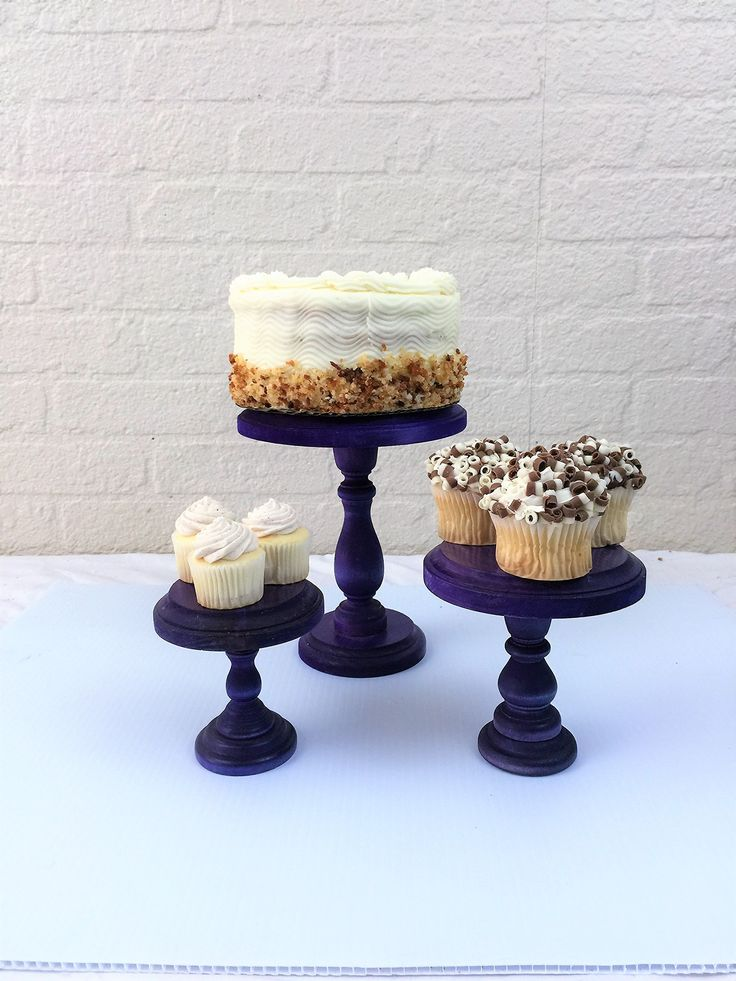 """Set of 3 Purple Round Wood Cupcake Stands Display Pedestals. Please read our listing in full for policies and shipping times as well as dimensions of each item. Set of 3 Round wood cupcake stands or display risers. These pieces have so many uses and are a beautiful accessory on any table. Use as a cupcake stands, cake stands, display risers or a multitude of other uses. These solid wood cake stands have routed edges for a decorative finish. The largest stand is 8"""" tall and 6"""" wide, the..."""