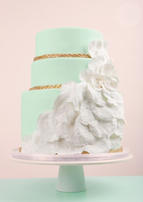 Mint Green Wedding Cake with Gold Trim & Cascading White Flower Petals