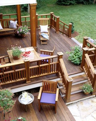 Traditional outdoor furniture still works. Adding coloured chair cushions gives your outdoor deck some personality and breaks up the wood on wood look.