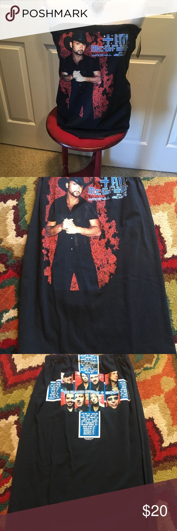 Boutique hand made Tim McGraw concert tube top New with tag boutique hand made recycled concert tee tube top.  One size fits most.  Top is shown measured unstreached.  Featuring Tim McGraw. Perfect for upcoming concerts or nights out on the town.  Feel free to make a reasonable offer using the offer feature or bundle and save. boutique Tops