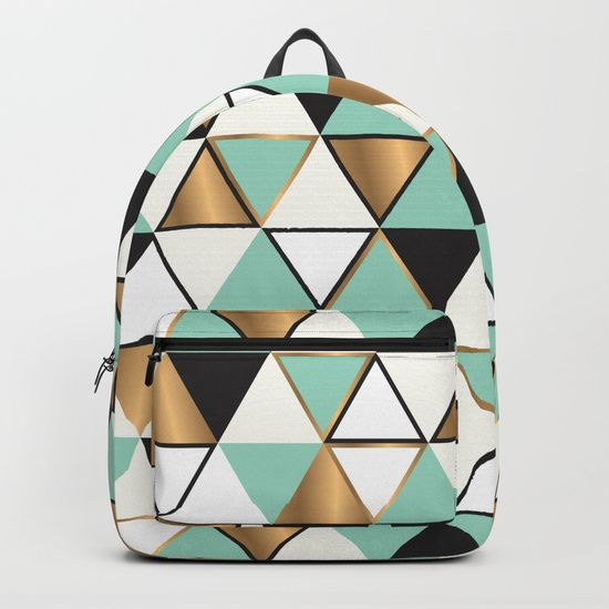 Abstract triangles in gold, black and turquoise Backpacks by Amanda Bussio. Worldwide shipping available at Society6.com. Just one of millions of high quality products available.
