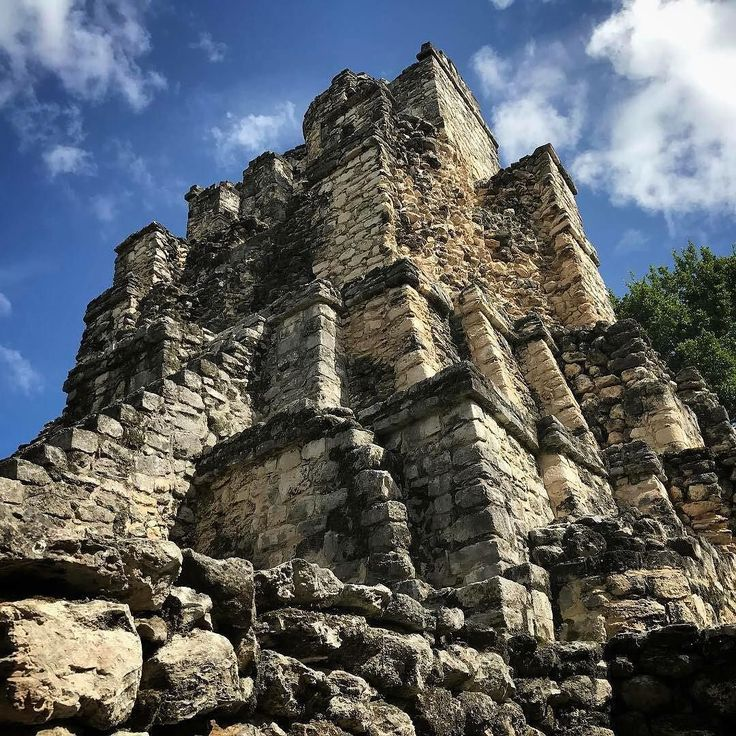 """""""Exploring the sky"""" By Nacho Ravelo  Muyil Ruins Felipe Carrillo Puerto Quintana Roo Mexico - #mayanruins #ruins #tulum #sky #clouds #blue #history #caribbean #proud #visitmexico #quintanaroo #rivieramaya #dream #heaven #passion #getaway #incredible #goals2017 #bestplaces2017 #traveler #wanderlust #lifeisgood #neverstopexplore #proudofmexico #life tagme or use hastag #qoolmx and share your Quintana Roo Mexicos Majestic Paradise!"""