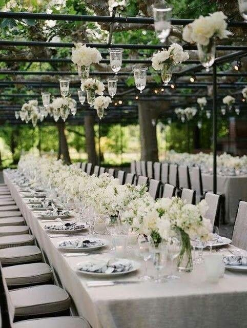 white centerpiece flowers,  hanging candles and flowers, natural color linen and chair pads